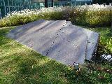 slabs and pond in center of Kryptos Courtyard Lawn
